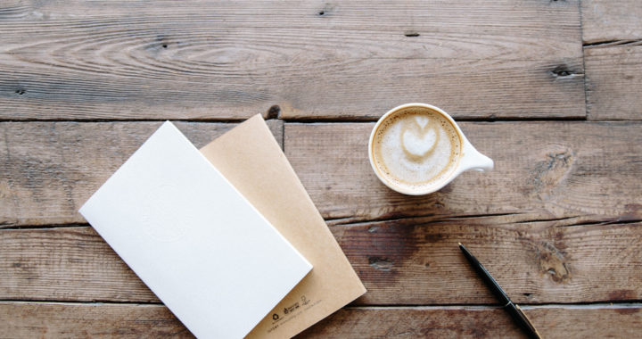 Blank card and cup of coffee