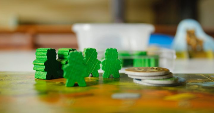 Wooden board game figures on a board