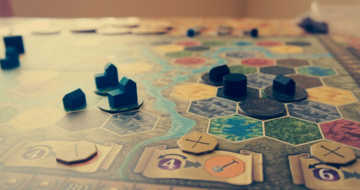 Close up of a strategy game board with wooden pieces