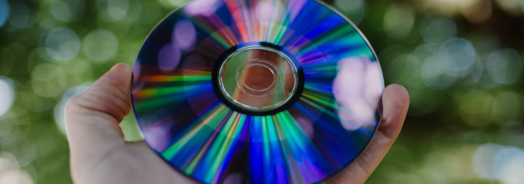 Hand holding compact disc