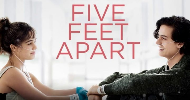 A teenage boy and girl with oxygen tubes sitting across from another with the words Five Feet Apart between