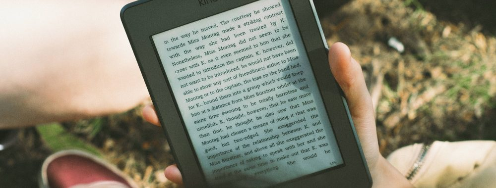Person reading on an Amazon Kindle