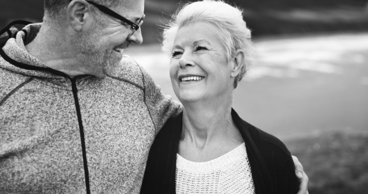 Black and white picture of a man and woman looking at one another