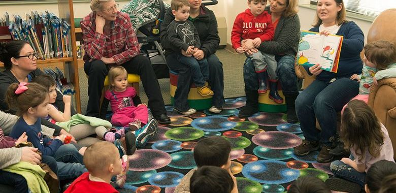 Families gathered for library storytime