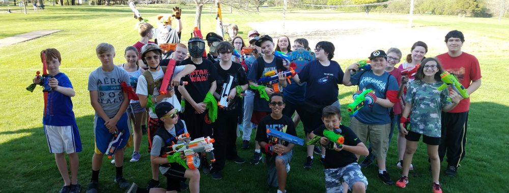 Group of teens holding nerf guns