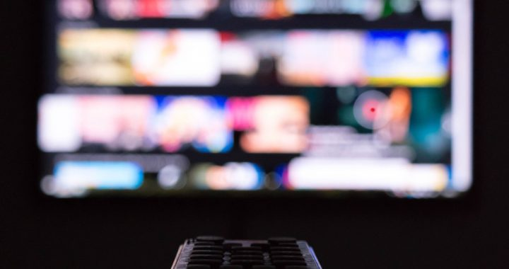 Remote pointed toward an out-of-focus television