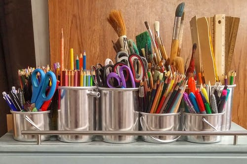Art supplies in silver paint cans