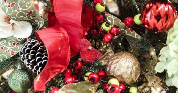 Wreath with red ribbon, pinecones, and ornaments