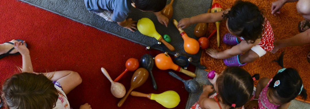 Kids playing with maracas
