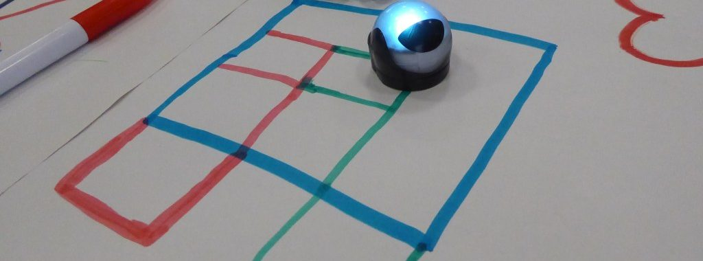 Ozobots following a maze on white paper
