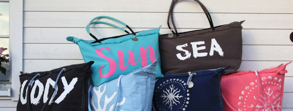 Tote bags lined up on a bench