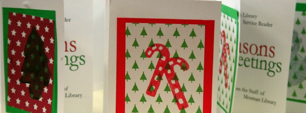 Several Christmas cards in red and green