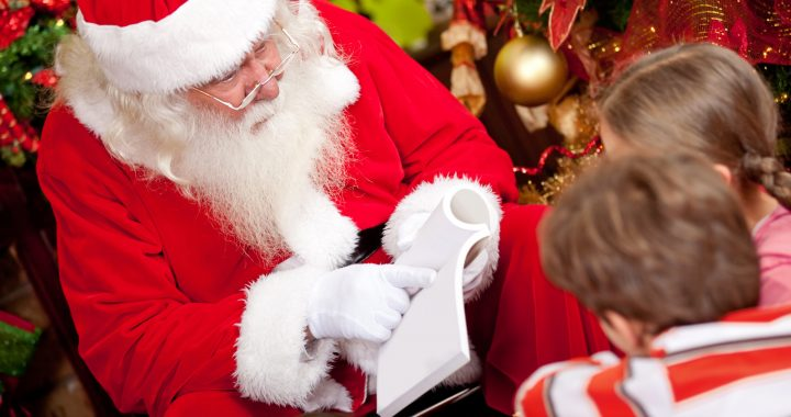 Santa Claus reading a story to a group of kids