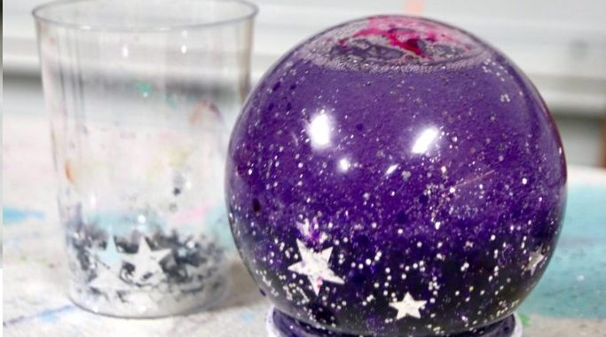 purple snow globe with stars in it