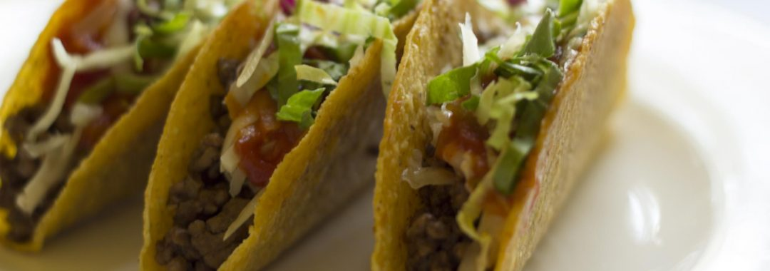3 beef tacos with lettuce and tomato