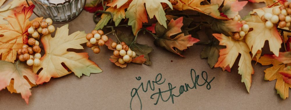 Fall leaves and the words give thanks