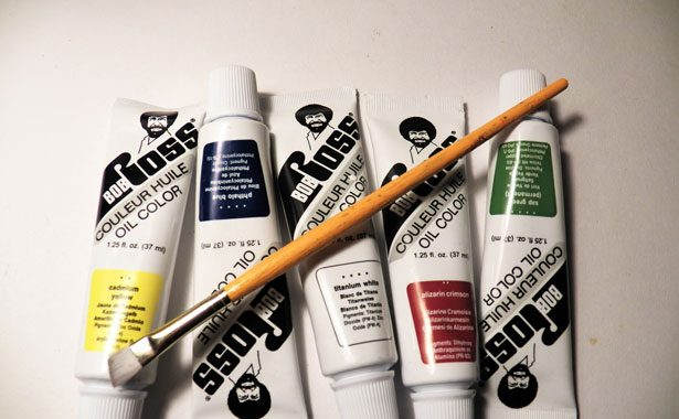 tubes of Bob Ross paint with paint brush