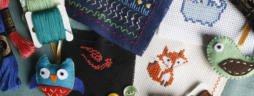 Collection of embroidery and needlework samples and supplies