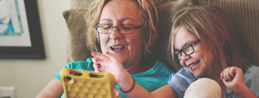 Woman and young girl using a tablet together