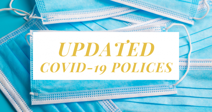 Pile of blue surgical masks with text Updated Covid-19 Policies